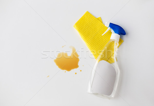 cleaning rag, detergent spray and spilled stain Stock photo © dolgachov