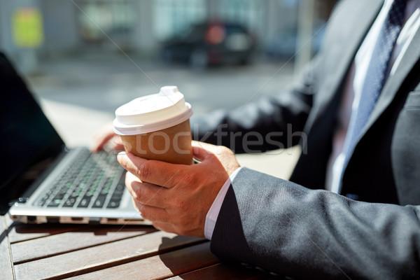 senior businessman with laptop and coffee outdoors Stock photo © dolgachov
