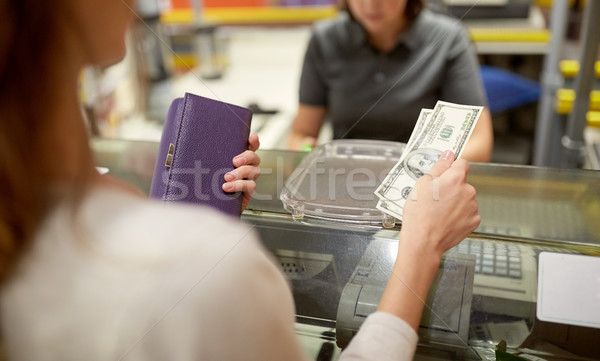 woman paying money at store cash register Stock photo © dolgachov