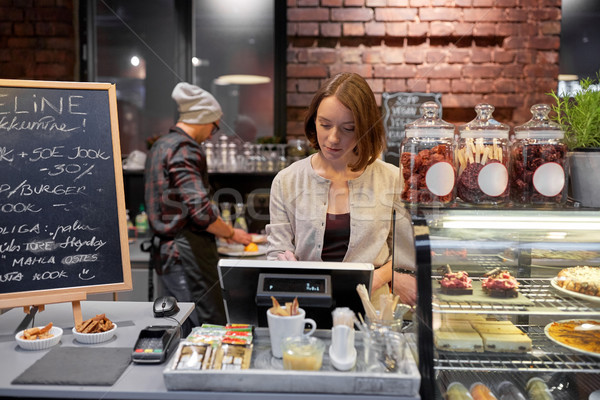 woman or barmaid with cashbox at cafe Stock photo © dolgachov
