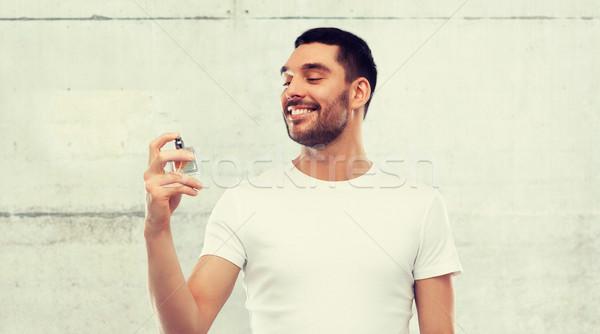 Gülen adam erkek parfüm gri parfümeri Stok fotoğraf © dolgachov