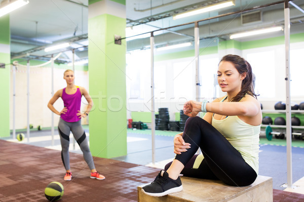 women with fitness tracker and ball in gym Stock photo © dolgachov