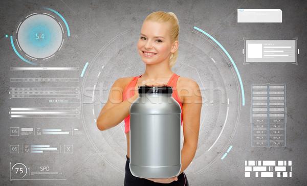 Sorridente mulher jarra proteína fitness Foto stock © dolgachov