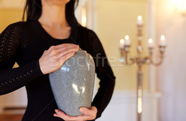 close up of woman with cremation urn in church Stock photo © dolgachov