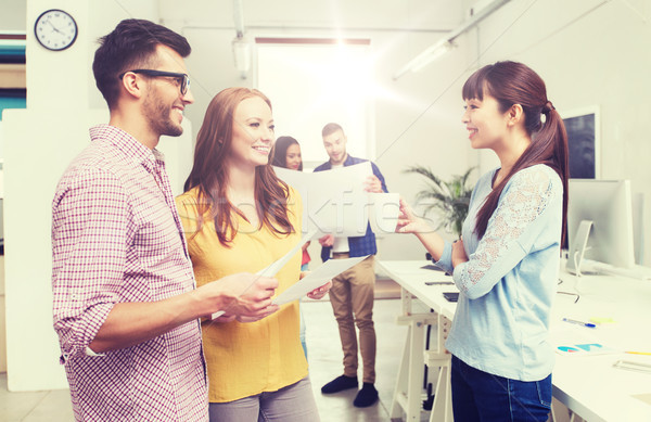 creative team on coffee break talking at office Stock photo © dolgachov