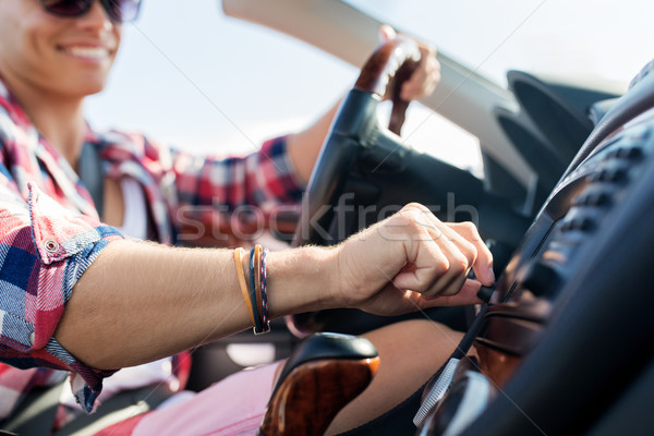 Stock photo: happy young man driving convertible car