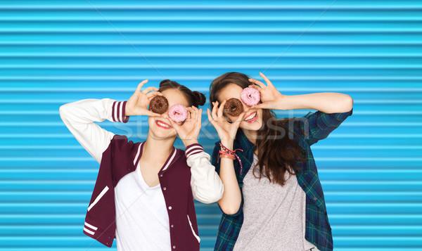 happy pretty teenage girls with donuts having fun Stock photo © dolgachov
