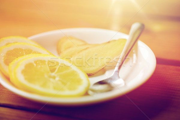 lemon and ginger on plate with spoon Stock photo © dolgachov