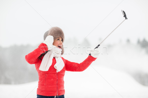 happy woman with selfie stick outdoors in winter Stock photo © dolgachov