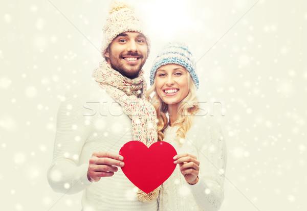 Sorridere Coppia inverno vestiti rosso cuore Foto d'archivio © dolgachov