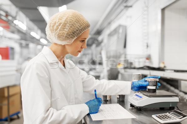 woman working at ice cream factory Stock photo © dolgachov