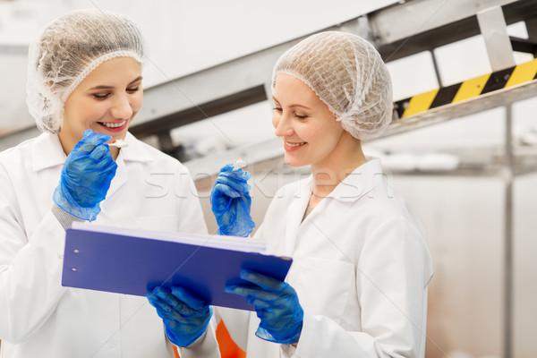 Mulheres degustação sorvete fábrica comida produção Foto stock © dolgachov