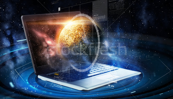 laptop with virtual planet and space hologram Stock photo © dolgachov