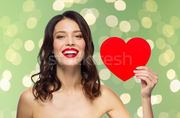 Güzel bir kadın kırmızı ruj kalp şekli sevgililer günü güzellik insanlar Stok fotoğraf © dolgachov