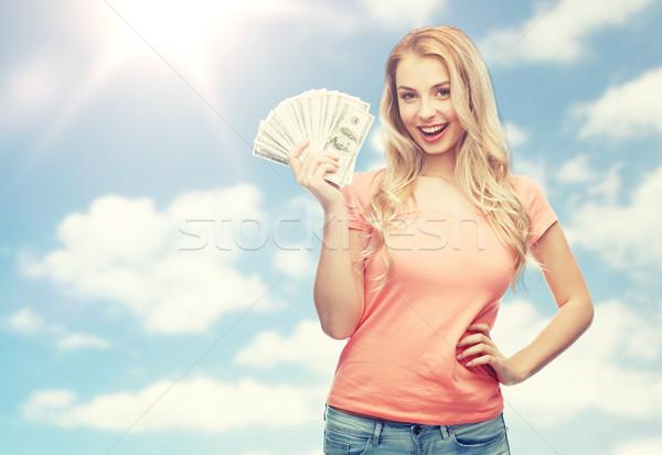 Mutlu genç kadın ABD dolar nakit para Stok fotoğraf © dolgachov