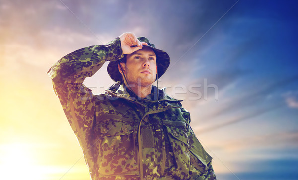 young soldier in military uniform over sky  Stock photo © dolgachov