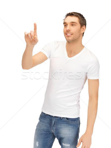 Homme travail quelque chose imaginaire bel homme blanche Photo stock © dolgachov