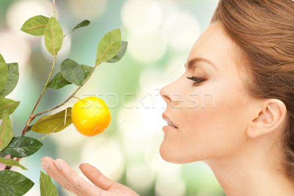 Stockfoto: Vrouw · citroen · takje · foto · vruchten · gezondheid