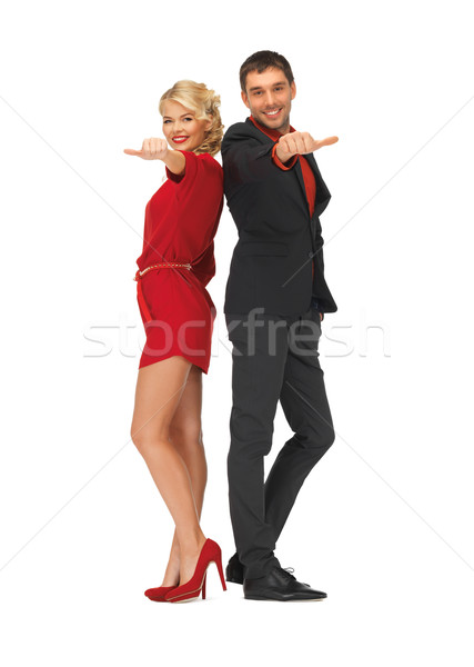 man and woman showing thumbs up, down Stock photo © dolgachov