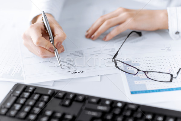 woman hand filling in invoice paper Stock photo © dolgachov