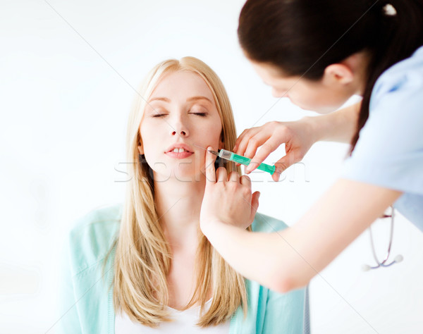 beautician with patient doing botox injection Stock photo © dolgachov