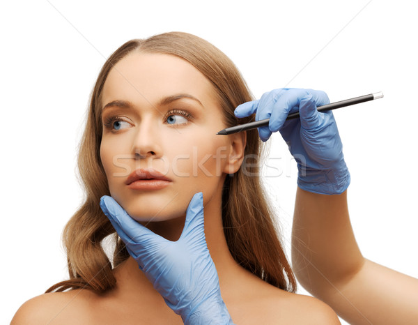 woman face and beautician hands with pencil Stock photo © dolgachov