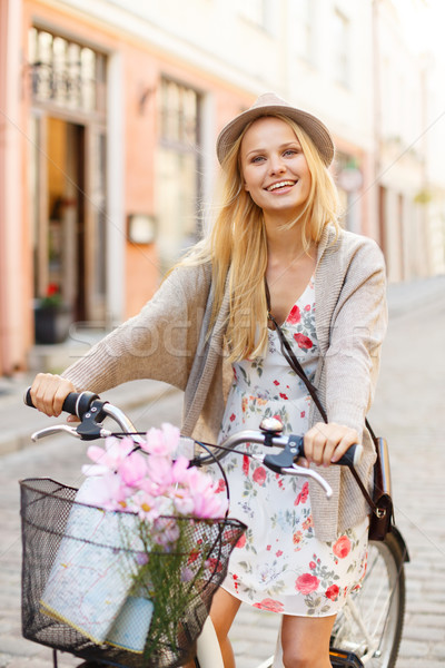 attractive woman in hat with bicycle in the city Stock photo © dolgachov