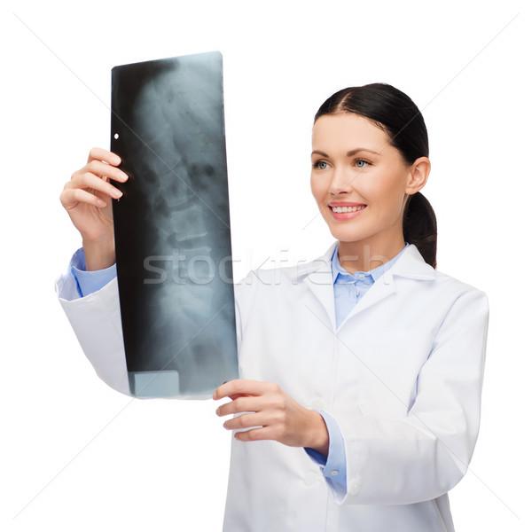 Lächelnd weiblichen Arzt schauen xray Gesundheitswesen Stock foto © dolgachov