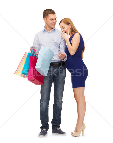 happy family expecting child with shopping bags Stock photo © dolgachov