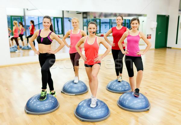 Gruppo femminile aerobica metà palla fitness Foto d'archivio © dolgachov