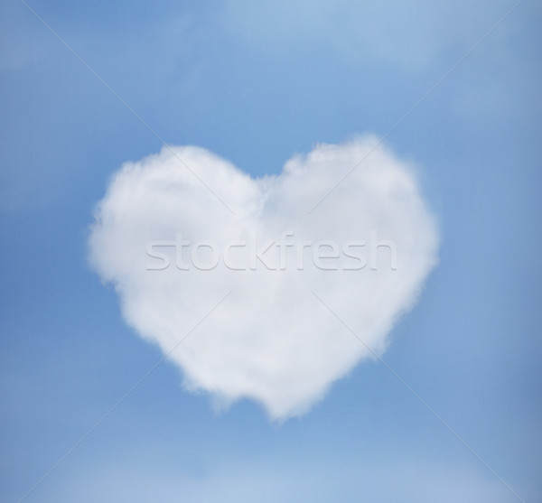 Stock photo: blue sky with heart from clouds