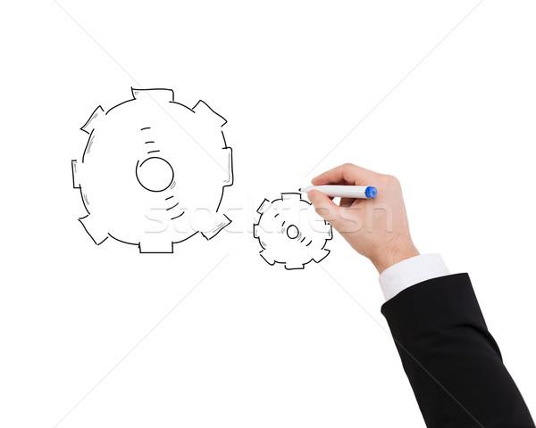 close up of businessman drawing cogwheel Stock photo © dolgachov