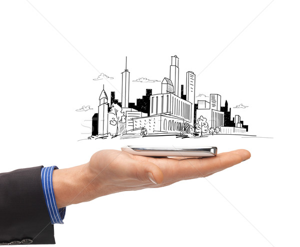 close up of man hand with smartphone city sketch Stock photo © dolgachov