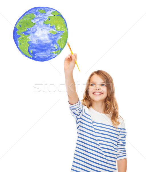 cute little girl drawing with brush planet earth Stock photo © dolgachov