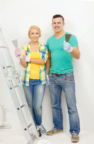 Stock photo: smiling couple doing renovations at home