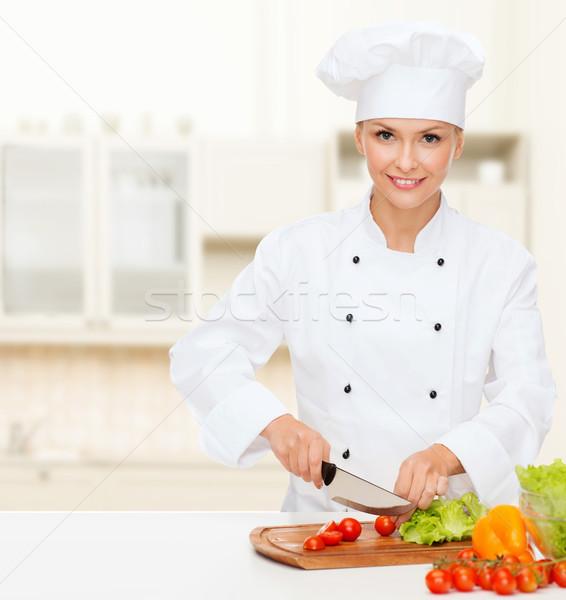 Gülen kadın şef sebze pişirme Stok fotoğraf © dolgachov