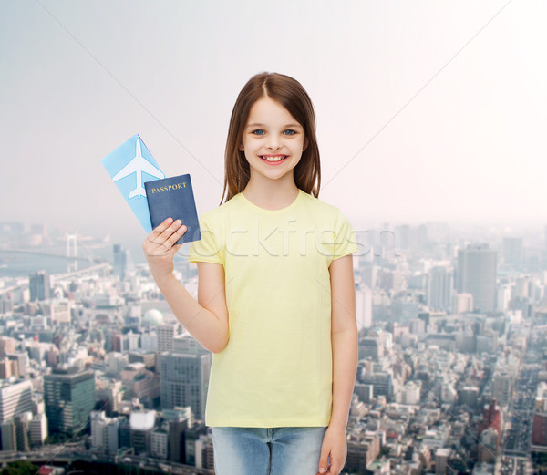 smiling little girl with ticket and passport Stock photo © dolgachov