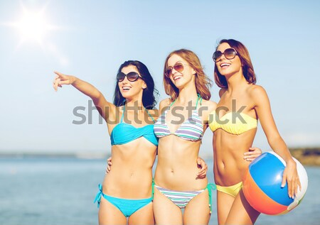 Stock photo: two smiling women making selfie on beach