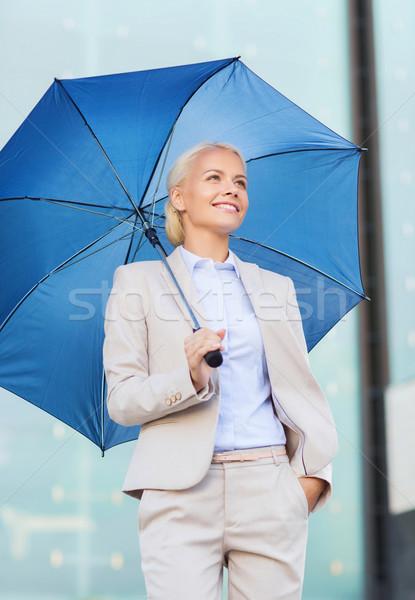 Genç gülen işkadını şemsiye açık havada iş Stok fotoğraf © dolgachov