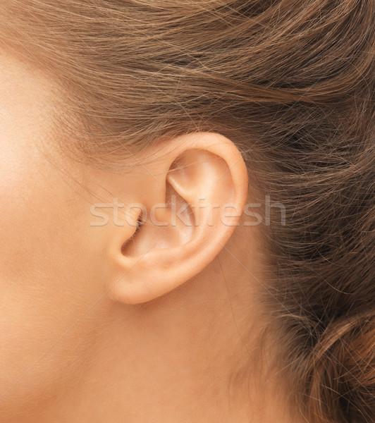 Oreille santé beauté piercing femme Photo stock © dolgachov