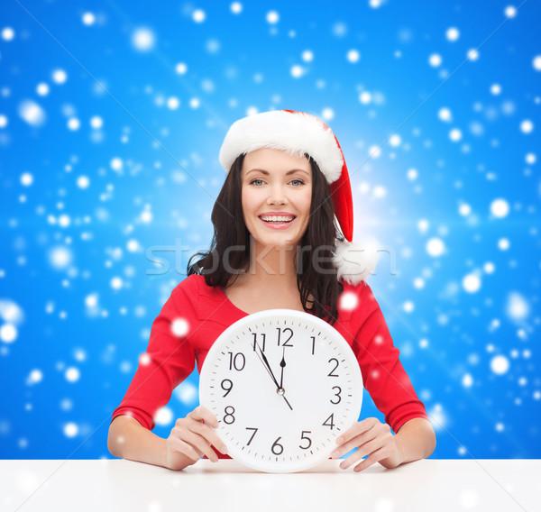 Glimlachende vrouw helper hoed klok christmas Stockfoto © dolgachov