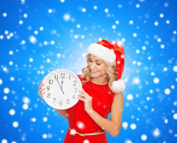 Sorrindo ajudante seis relógio natal Foto stock © dolgachov