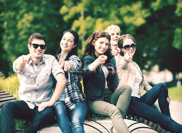 group of students or teenagers pointing fingers Stock photo © dolgachov