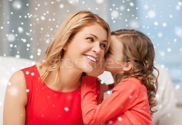 Feliz mãe menina ouvido pessoas Foto stock © dolgachov
