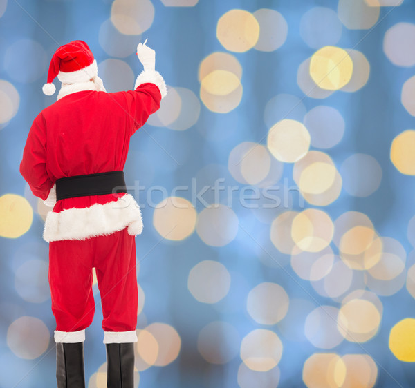 man in costume of santa claus writing something Stock photo © dolgachov