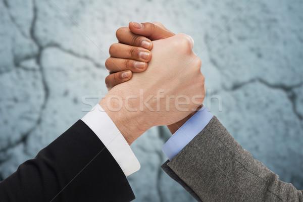 Handen arm worstelen beton muur zakenlieden Stockfoto © dolgachov