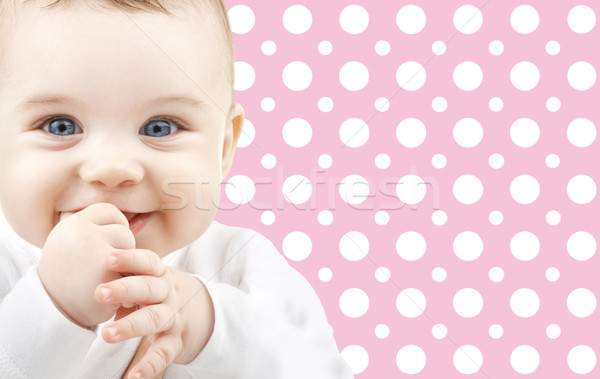Mosolyog kislány arc rózsaszín pöttyös gyermekkor Stock fotó © dolgachov