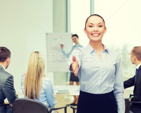 üzletasszony kinyitott kéz kész kézfogás üzlet Stock fotó © dolgachov