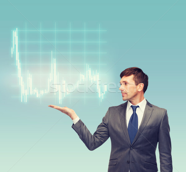 buisnessman or teacher showing forex chart Stock photo © dolgachov