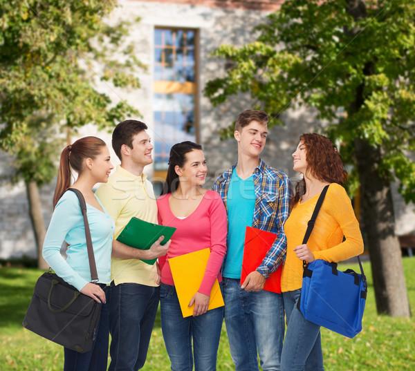 group of smiling teenagers Stock photo © dolgachov
